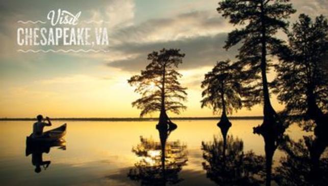 Reflective water Sunset at Lake Drummond Chesapeake, VA puzzle
