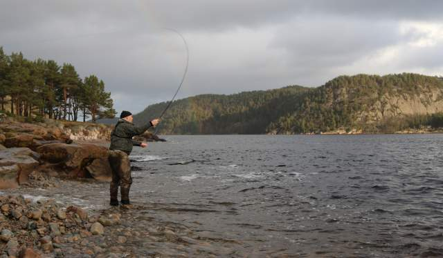 Man fishing at Sniksfjorden on a cloudy day