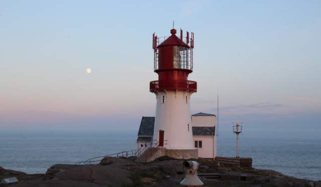 Moon over Lindesnes lighthouse in southernmost Norway
