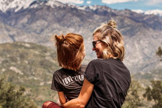 Mom and daughter enjoying scenic mountains