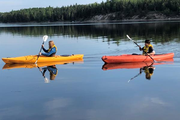 People kayaking in the Whiteshell with Eduvacay