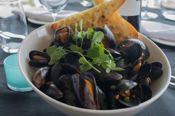 Feasting on mussels above the Winnipeg skyline at Prairie 360