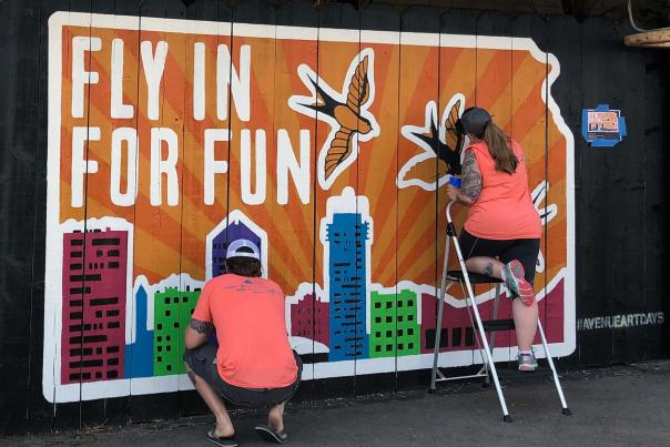 Artists Finishing an Avenue Art Days Mural in 2019