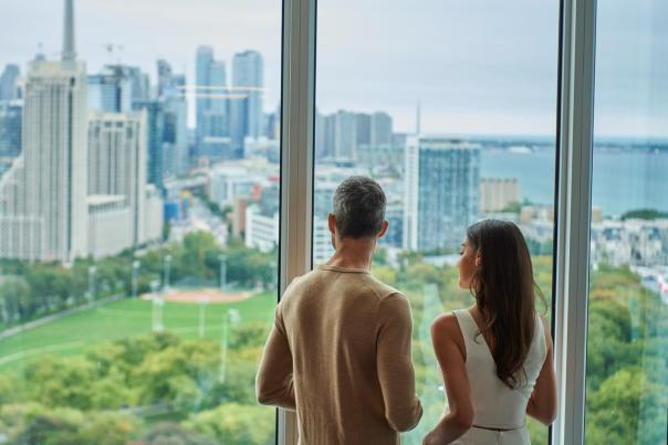 A couple looks out at the Toronto skyline from Hotel X