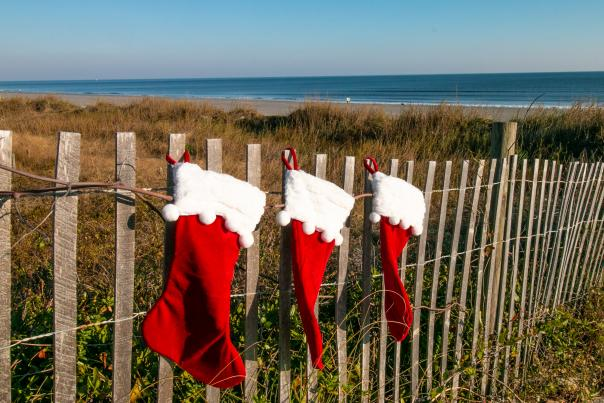 Christmas Stockings on Sand Fence at Beach