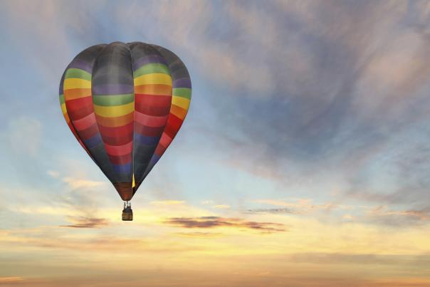 A colorful hot air balloon in the sky during sunrise