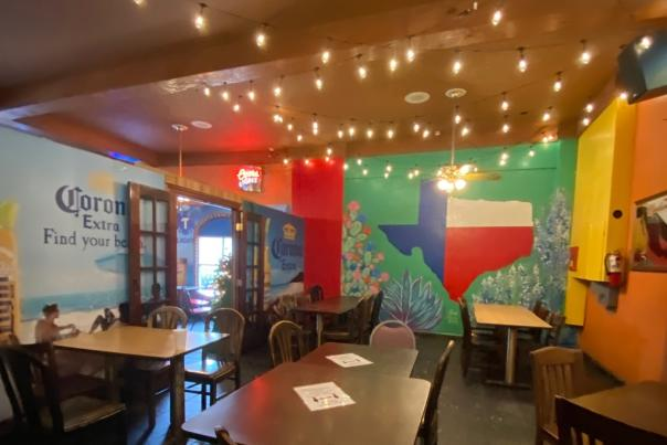 The dining area at Elena's in Beaumont is decorated in a colorful Texas theme.