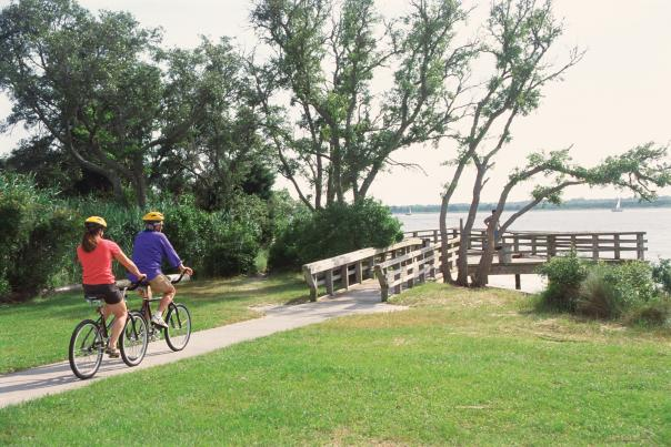 Two bicyclists riding on a path in the Carolina Beach State Park in North Carolina