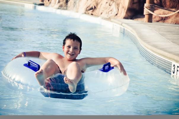 Splash Island boy on tube