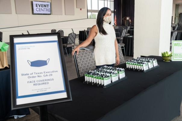 A table of complimentary facemasks for event attendees in Texas