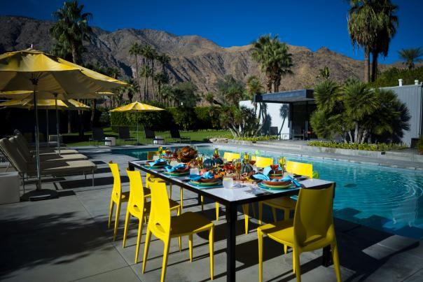 Thanksgiving by the pool with mountains and palm trees