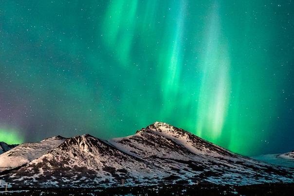 The northern lights high over the Chugach Mountains
