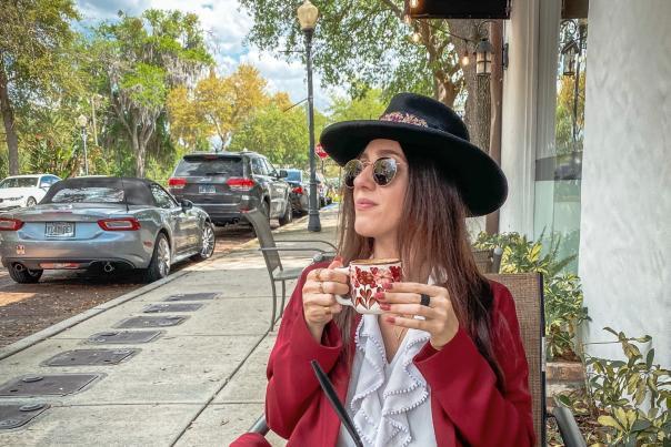 2021 Influencer Nakiesa Faraji-Tajrishi eating at CFS Coffee Shop in Winter Park