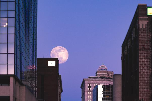 Large moon over downtown Grand Rapids.