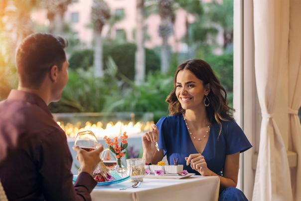 A couple enjoying Visit Orlando's Magical Dining on the patio at The Venetian Chop House
