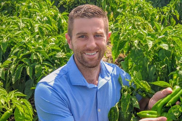 Chile Entrepreneur, Preston Mitchell, in hatch chile field in Mesilla