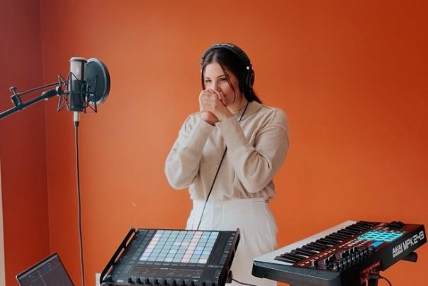 Christen Morrell stands at her recording studio.