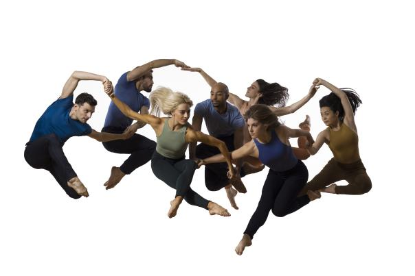Parson's Dance company, 7 dancers leaping in the air in unison.