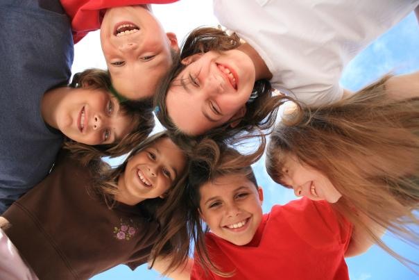 a group of six kids smiling