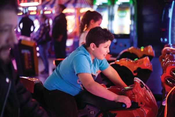 boy playing in an arcade
