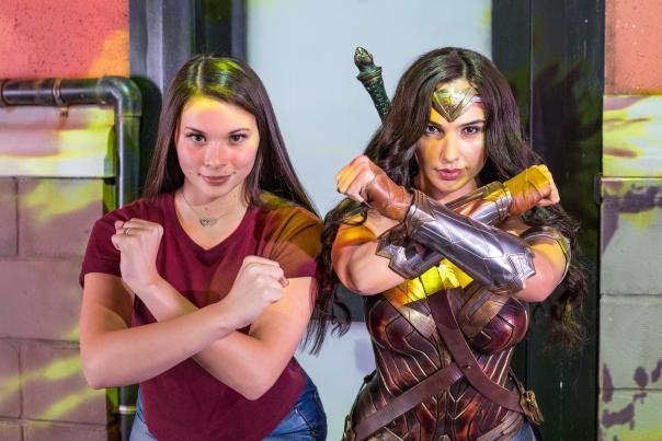 Woman poses with Wonder Woman at Madame Tussauds