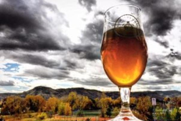 Beer glass with autumn mountain backdrop