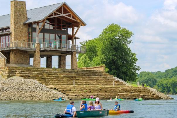 family kayaking on the Cumberland