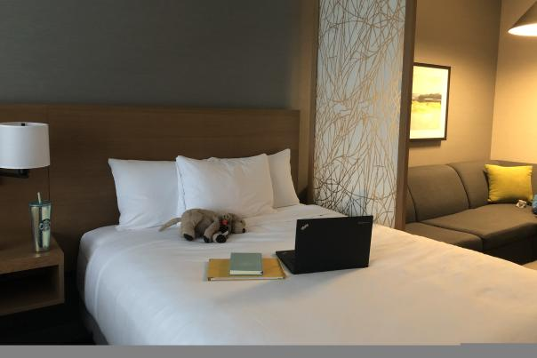 Work Station created on Bed at Hyatt Kelowna