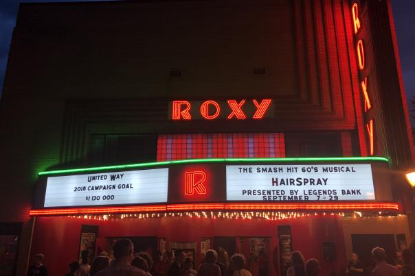 neon lighted theatre marquee