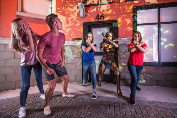 Group poses with Wonder Woman at Madame Tussauds