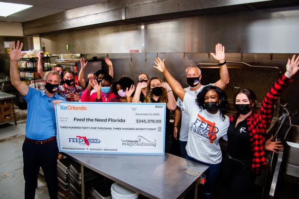 2020 Magical Dining check presentation to Feed the Need charity