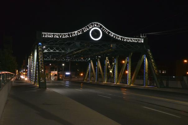 """The Queen Street bridge crosses over the Don River. The inscription: """"This river I step in is not the river I stand in"""" is borrowed from Greek philosopher Heracleitus, meaning that change is constant in life and experiences."""