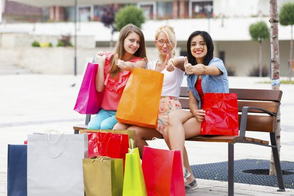 Three young women with their shopping bags