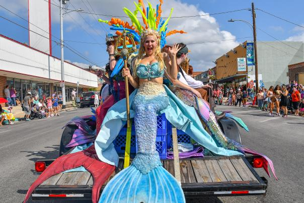 Festival float with mermaids on the back