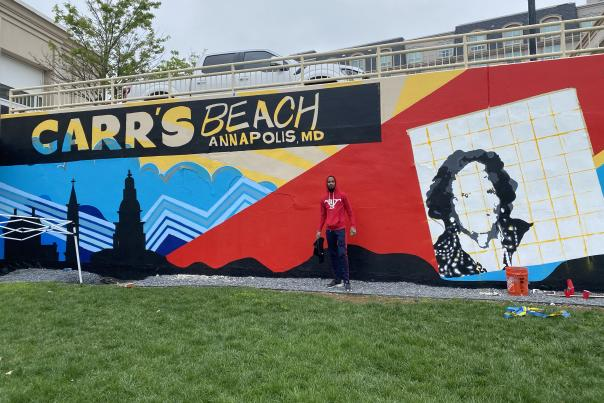Comacell in front of the Carr's Beach mural at MC3