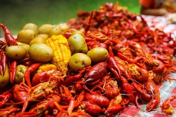 Crawfish have been prepared with corn-on-the-cob and potatoes for a community-style crawfish feast.