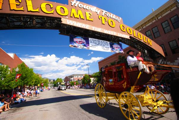 """Buffalo Bill Days Parade under """"welcome to golden"""" arch"""