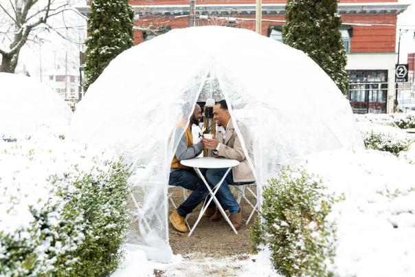 Couple in a cozy Dome in a winter setting.