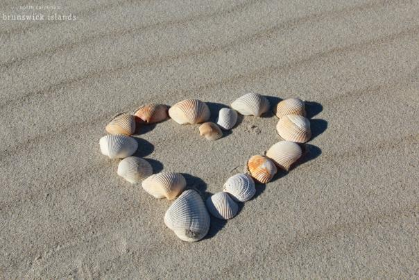 A heart made of shells on the beach in NC's Brunswick Islands