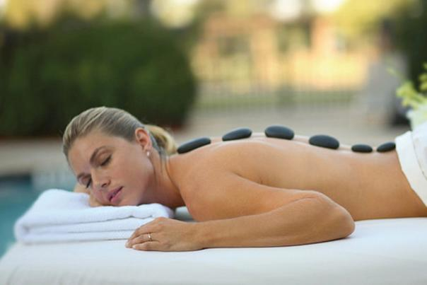 Orlando World Center Marriott woman getting a hot stone massage