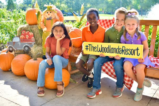 Kids posing with pumpkins at The Woodlands Resort