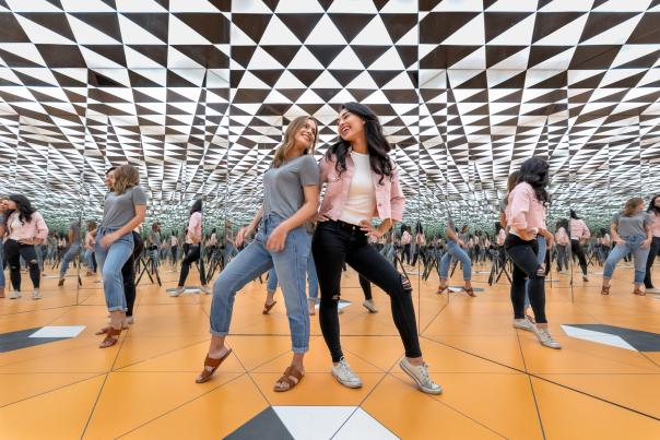 museum of illusions infinity room millenial girls