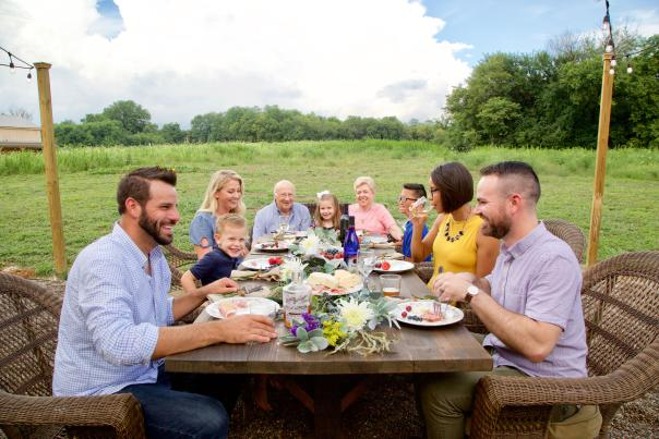 Group of people eating outdoors