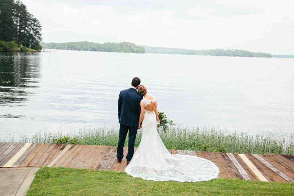 Bride And Groom Looking Out Over A Lake In Milledgeville, GA