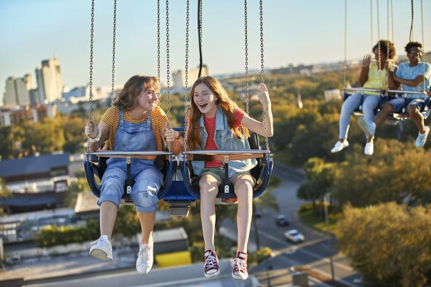 Two friends riding the Orlando Starflyer at ICON Park