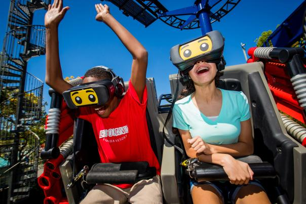 Guests laugh and thrill as they ride the Great LEGO Race at LEGOLAND Florida Resort