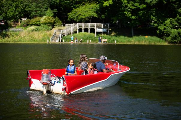 Enjoying the lake in a retro boat.