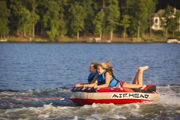 Two girls tubing on Lake Sinclair