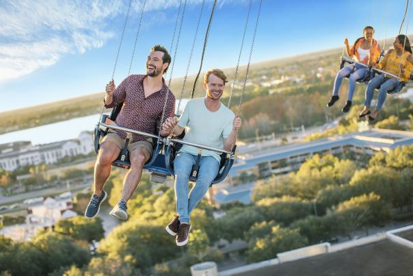 A gay couple riding the Orlando Starflyer at ICON Park