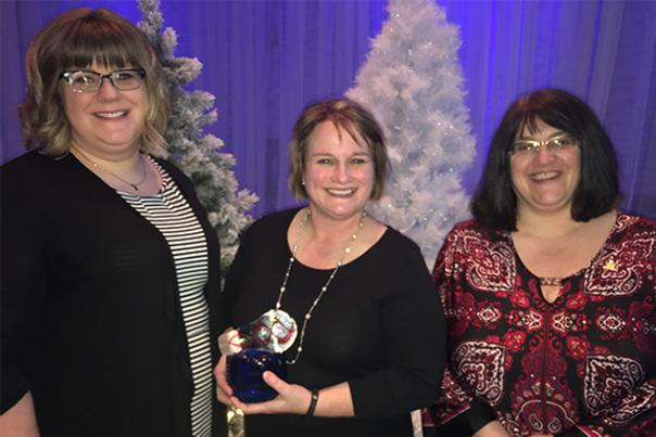 Kelly Stuible-Clark with the Wharton Center for Performing Arts, Julie Pingston with the Greater Lansing CVB and Catherine Blatnik with the Mid-Michigan Autism Association Receive Michigan Governor's Award for their Sensory-Friendly Program
